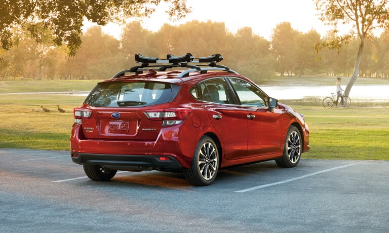 2020 Subaru Impreza in red parked in parkinglot for a park