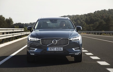 A blue Volvo XC60 driving down an open highway