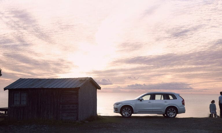 2020 Volvo XC90 side view park infront of a lake during sunset