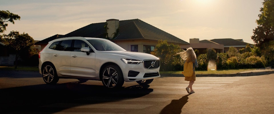 A white 2019 Volvo XC60 parked in a driveway