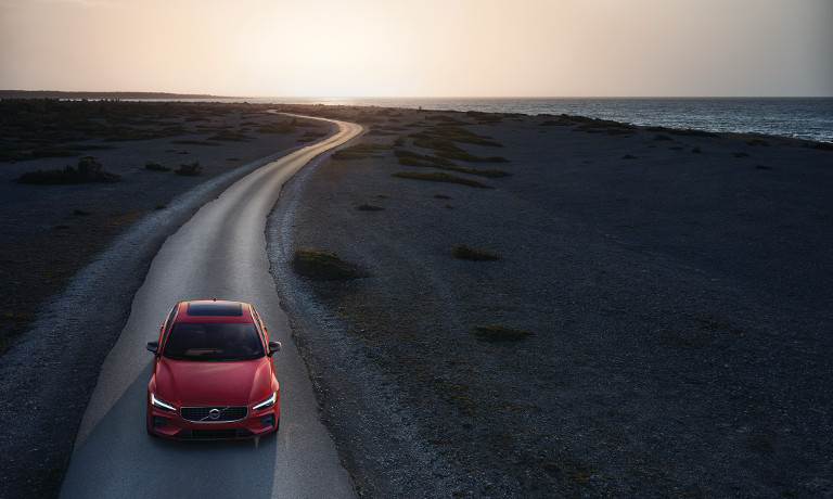 Red 2019 Volvo S60 on road