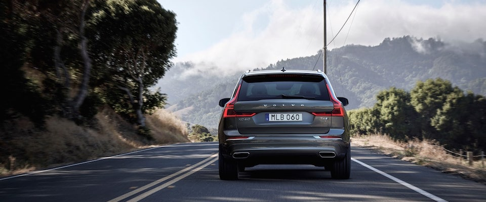 A Volvo XC60 driving away