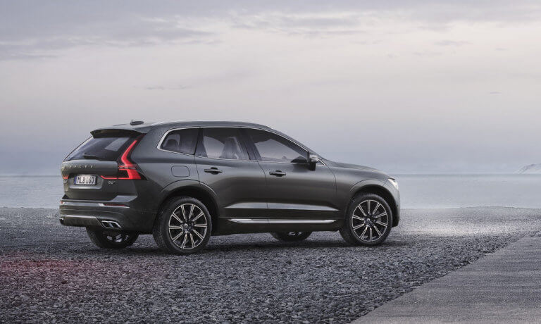 2021 Volvo XC60 parked on some gravel at a beach
