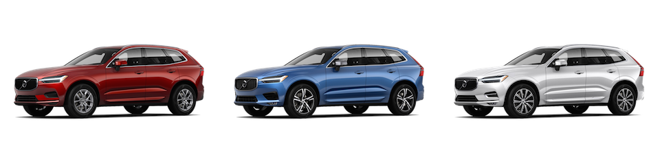 A red Volvo XC60 Momentum, a blue Volvo XC60 R-Design, and a white Volvo XC60 Inscription