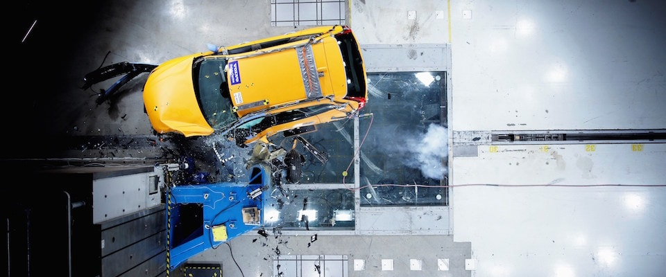 A safety crash test of a yellow Volvo XC60