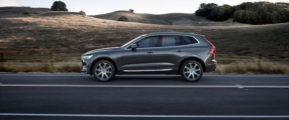 2019 Volvo XC60 driving down an open country road