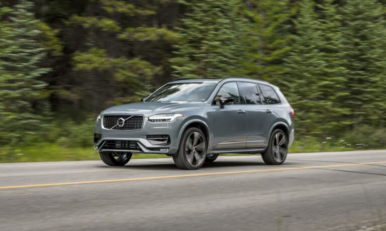 2020 Volvo XC90 Driving on a road by a forest