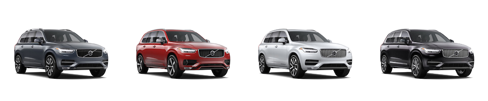 A grey Volvo XC90 Momentum, Red Volvo XC90 R-Design, White Volvo XC90 Inscription, and a Black Volvo XC90 Excellence