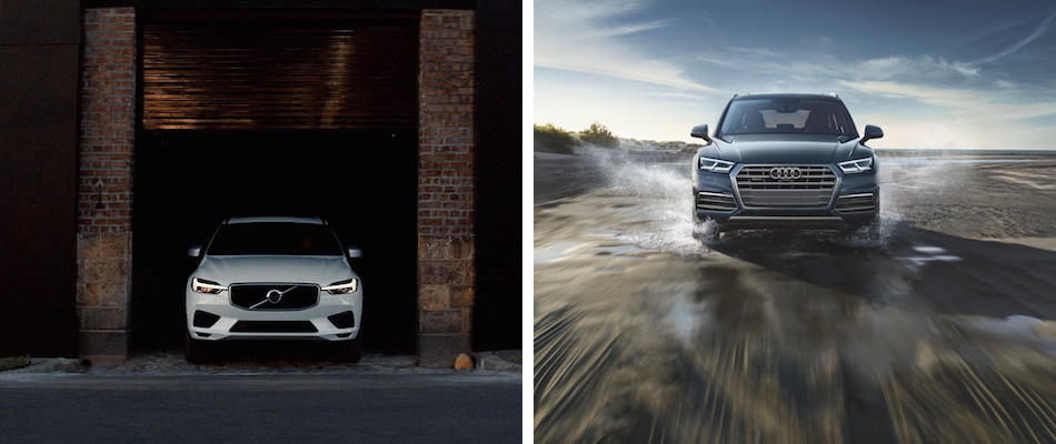 A 2019 Volvo XC60 driving out of a garage and a 2018 Q5 driving through a water puddle
