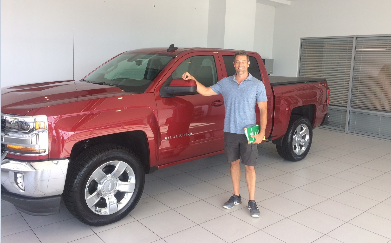 A Happy Brand-New Silverado 2018 Truck Buyer at McLoughlin Chevrolet