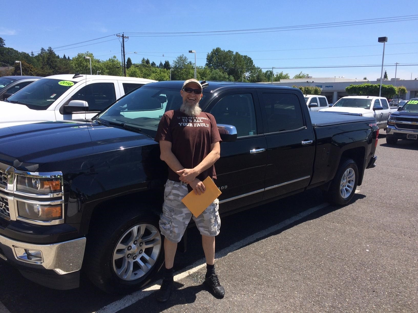 A Happy Silverado Truck Buyer with an approved Auto Loan from Mcloughlin Chevrolet in Portland Oregon