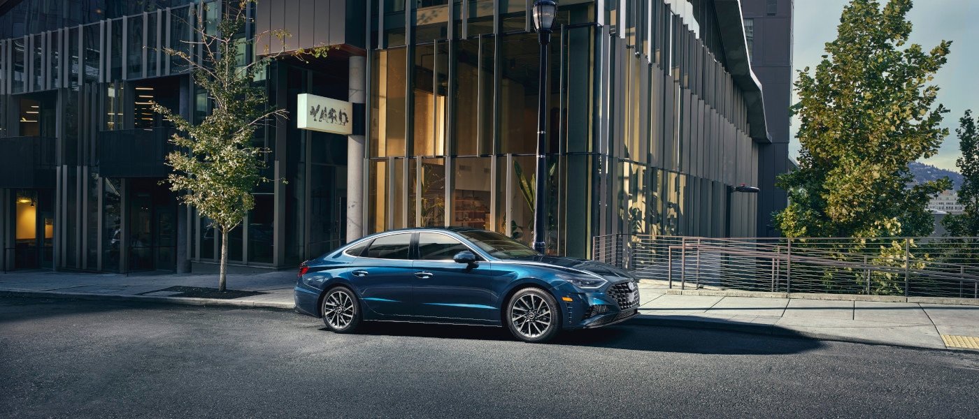 2021 Blue Hyundai Sonata Parked in Front of a Glass Building
