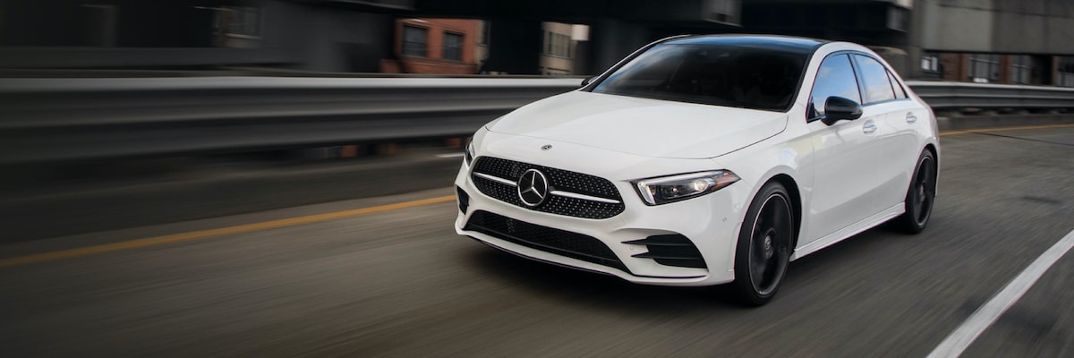 White Mercedes-Benz CLA driving down the road