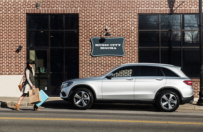 Silver Mercedes-Benz GLC parked outside a store
