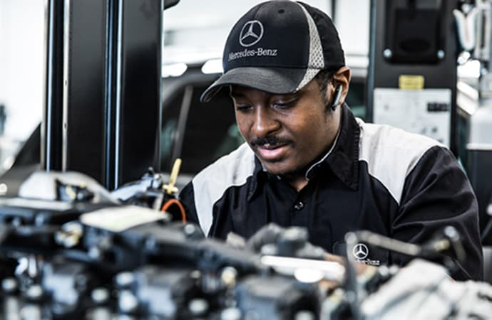 Mercedes-Benz service technician working on a vehicle