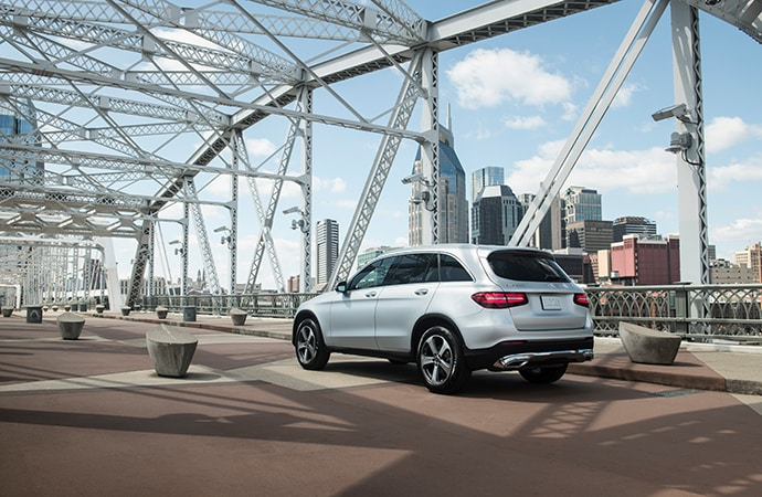 Silver Mercedes-Benz GLC driving over a bridge