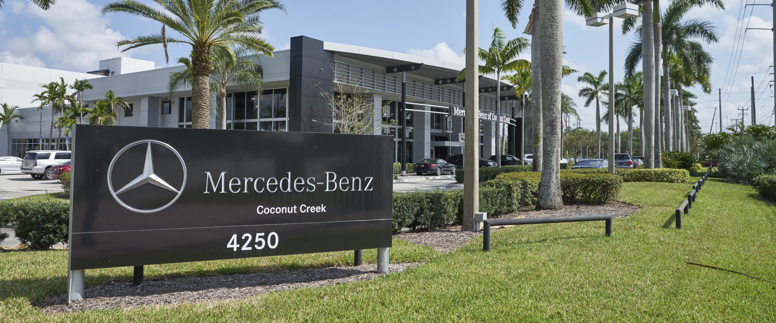 Exterior view of Mercedes-Benz of Coconut Creek during the day
