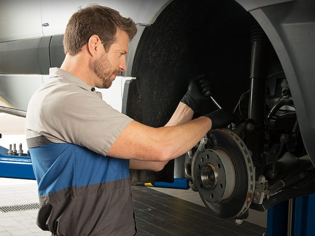 Technician servicing a Mercedes-Benz van