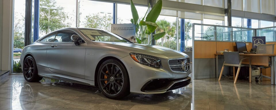 Mercedes-Benz of North Orlando finance center and showroom with a new Mercedes-Benz vehicle for sale