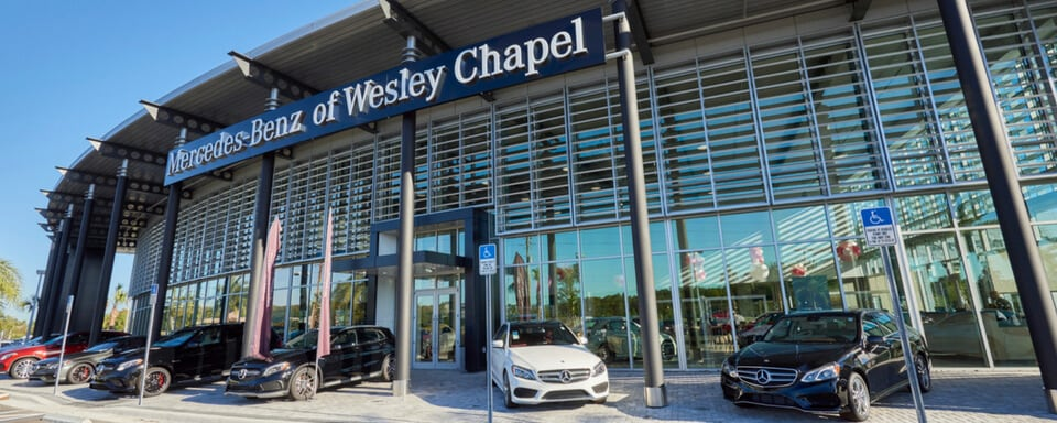 Exterior view of Mercedes-Benz of Wesley Chapel during the day