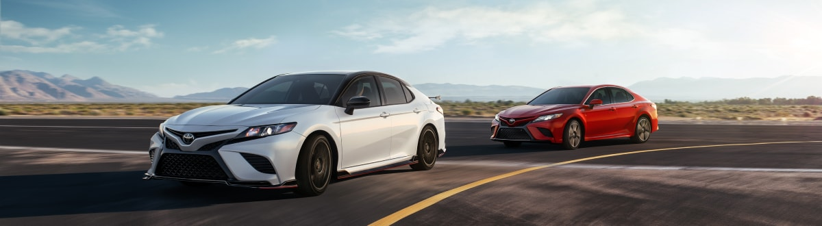 New Toyota Camry duo driving on the road