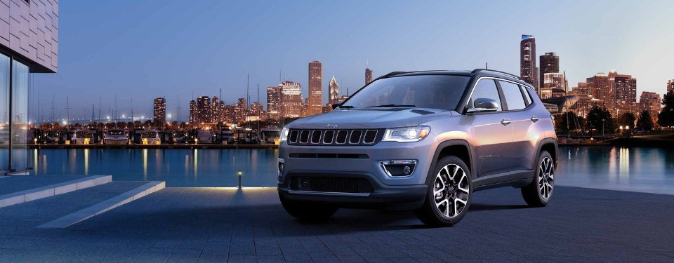 2019 Jeep Compass in front of city skyline