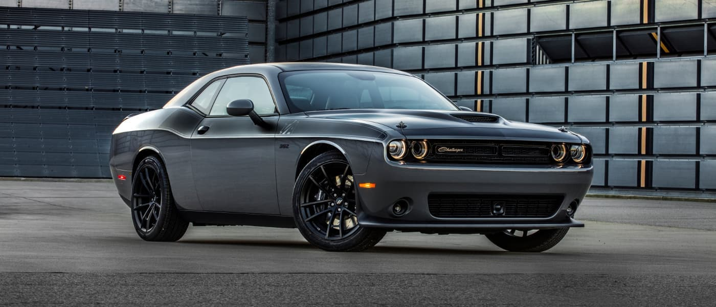 A silver Dodge Challenger parked on concrete