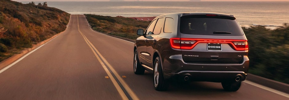 Dodge Durango diriving down an open road at sunset