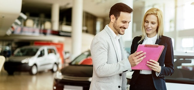A man an woman discussing car buying