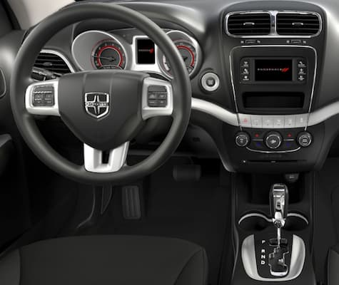 The steering wheel and infotainment system on the Dodge Journey