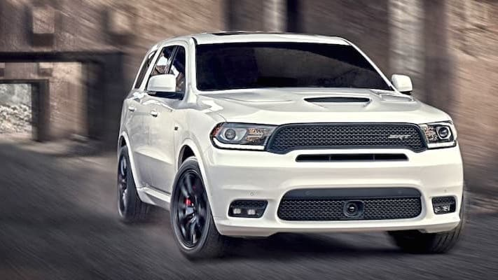 A white Dodge Durango driving through a tunnel