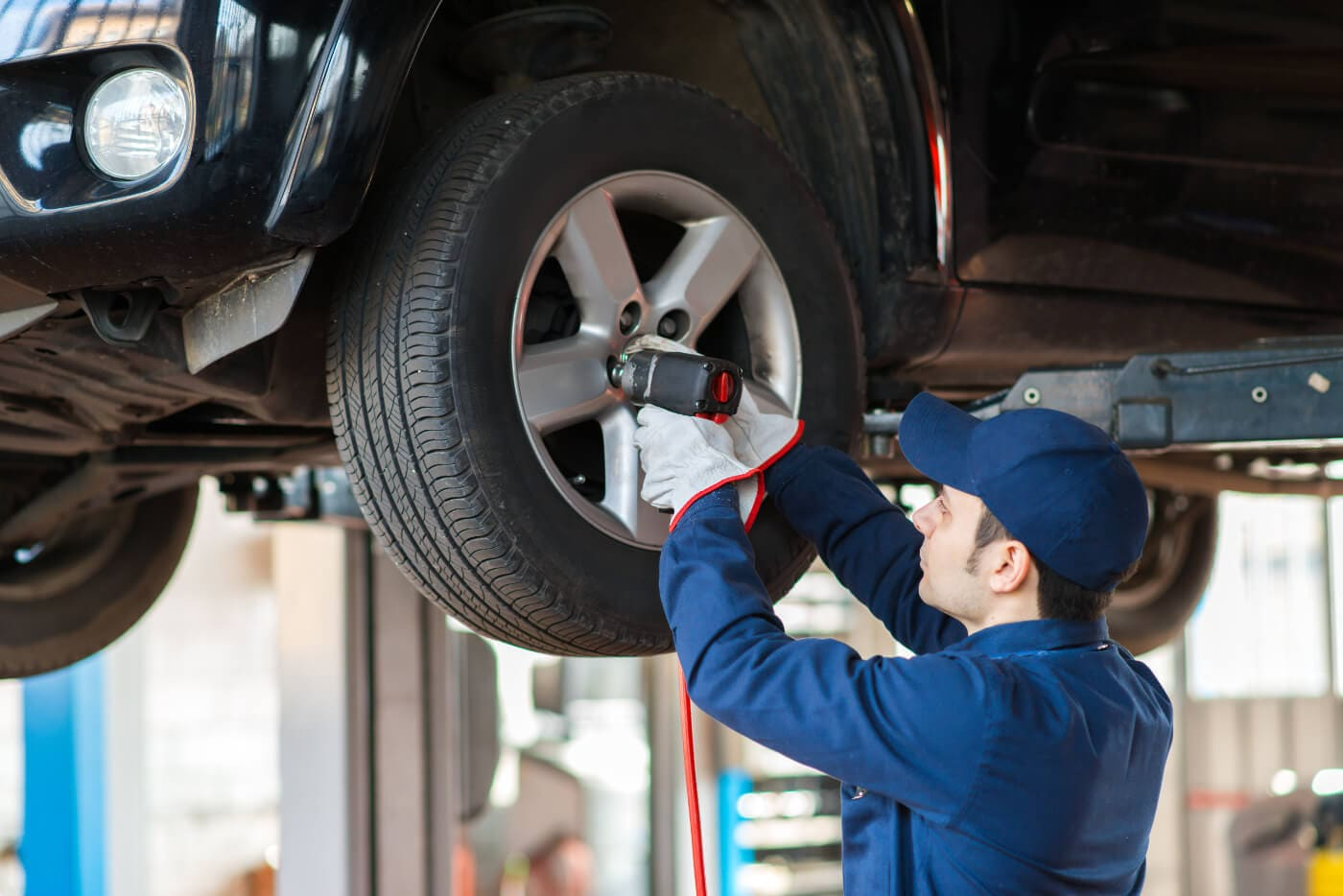 Service mechanic working on a tire