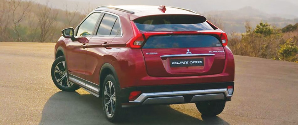 A red Eclipse Cross parked at a look out
