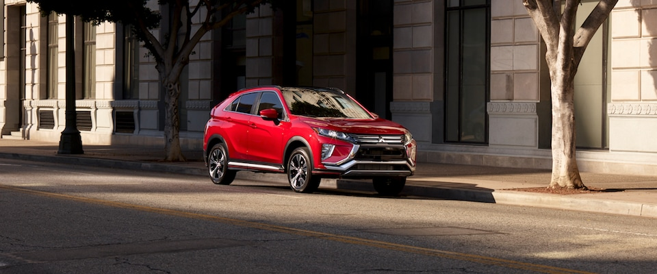 A red 2019 Mitsubishi Eclipse Cross parked on the street
