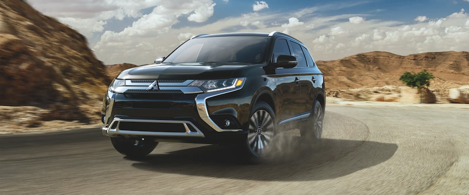 A black 2019 Mitsubishi Outlander GT driving through desert