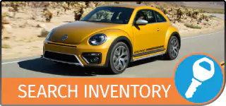Graphical Button with the text Search Inventory, showing a VW New Beetle Hatchback driving on a desert road, and a Key icon