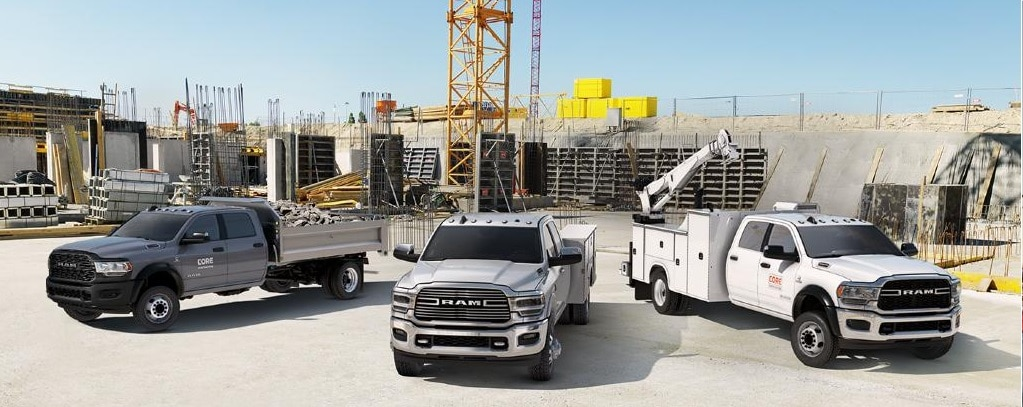 2020 5500 Chassis Cab Tradesman in  Maximum Steel Metallic with Chrome Package and Dump Upfit; 2020 3500 Chassis Cab Laramie in Billet Silver Metallic; 2020 5500 Chassis Cab Tradesman in Bright White with Mechanical Upfit.
