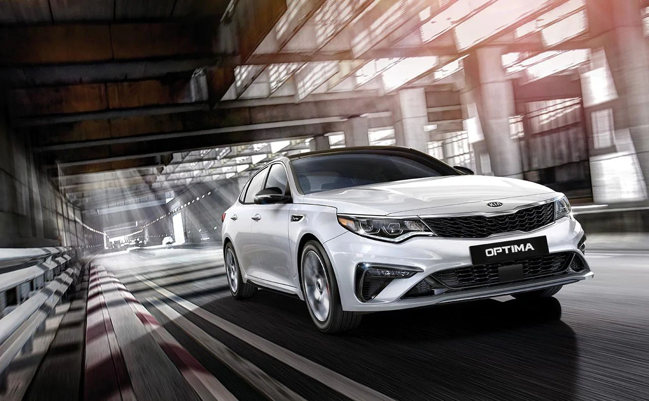 Kia Optima Sedan Speeding down underpass