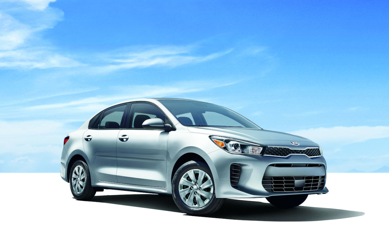 New Kia Rio In Bright Desert with a Blue Sky