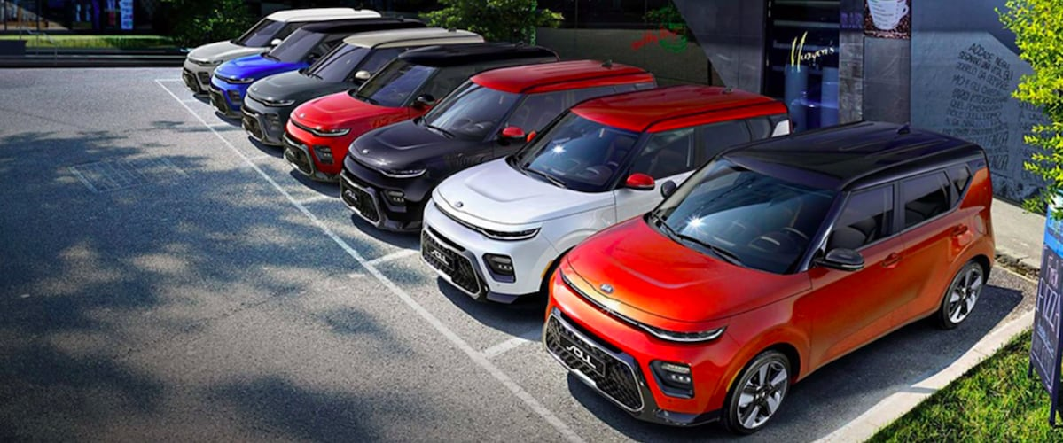 Colorful Kia Souls parked in a row