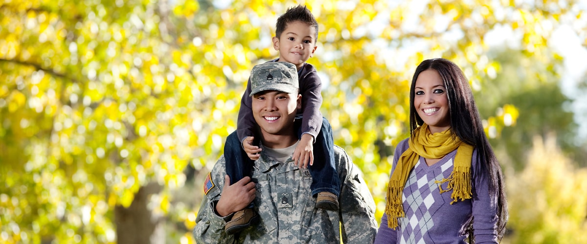 Military Family smiles at camera