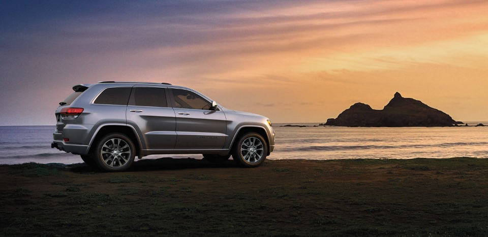 A 2018 Jeep Grand Cherokee on a beach