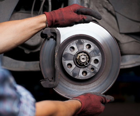 A technician working on fixing brakes