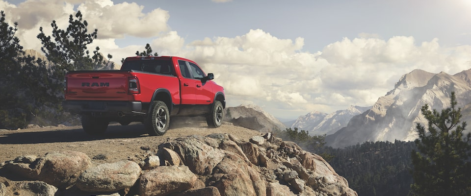 A red 2019 Ram 1500 over looking mountain scenery