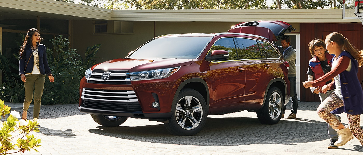 2019 Toyota RAV4 parked in a driveway with kids playing nearby