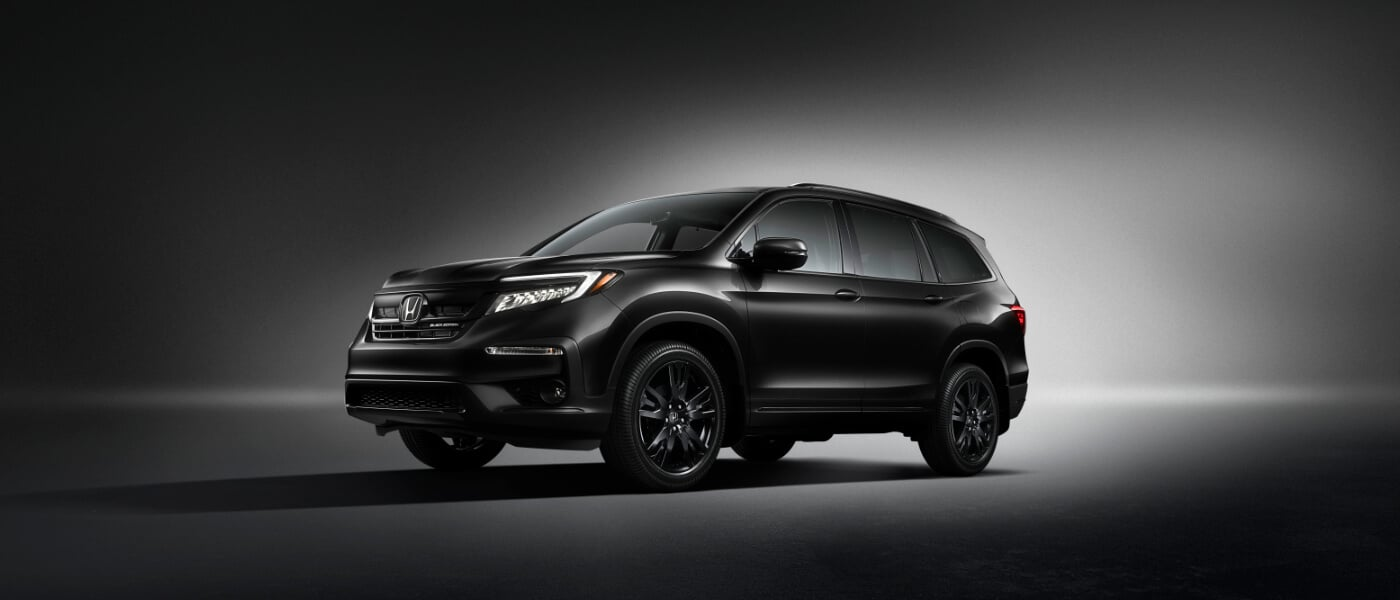 2020 Honda Pilot in black parked in dark room