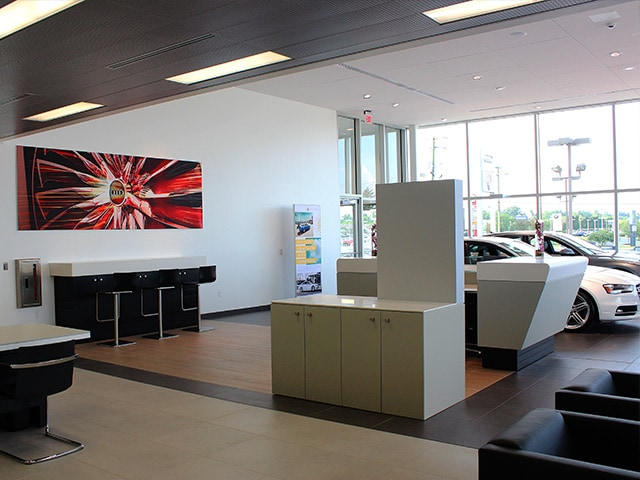 Audi Fort Wayne showroom with paintings