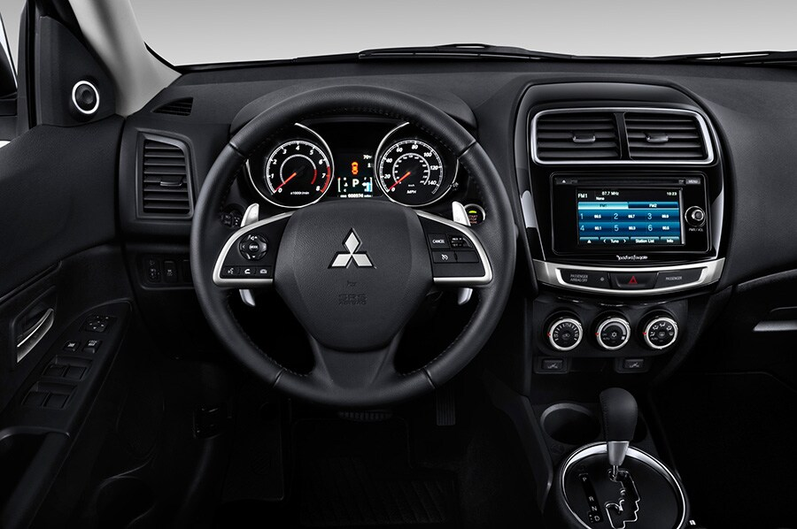 Despite its compact dimensions, the Mitsubishi Outlander Sport's back seat is spacious enough to accommodate adults comfortably. Even though the automobile ...