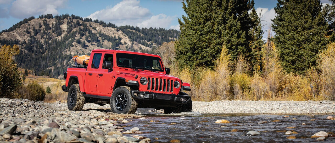 Red 2020 Jeep Gladiator near stream