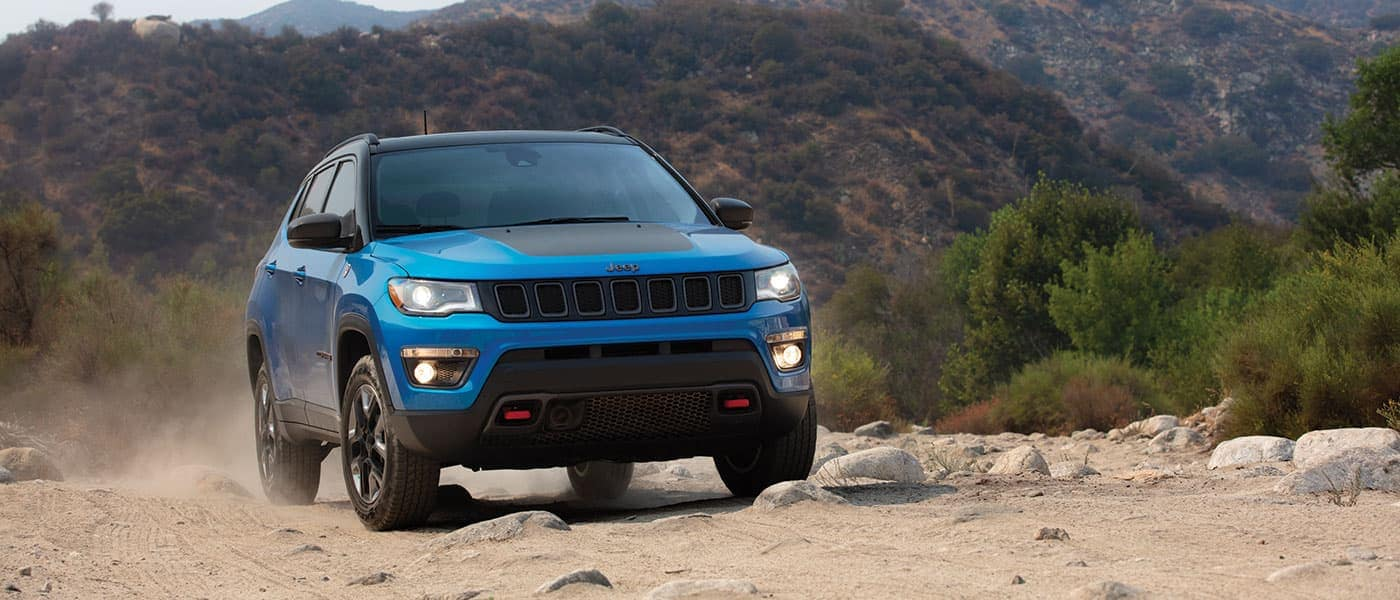 2019 Jeep Compass driving on dirt